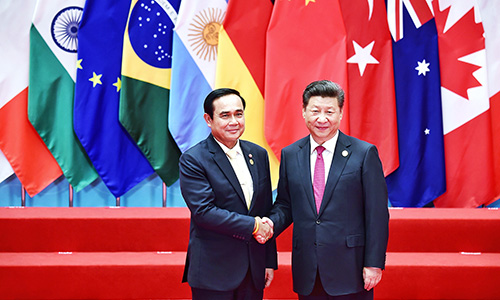 Prayut-Chan-o-cha-and-Xi-Jinping-at-G20-photo-MFA-01-500.jpg
