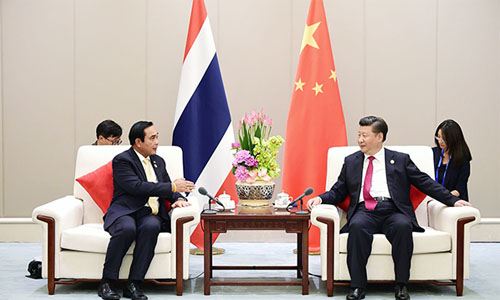 Prayut-Chan-o-cha-and-Xi-Jinping-at-G20-photo-MFA-02-500.jpg